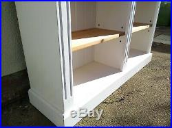 White painted wooden double bookcase with adjustable shelves